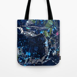 the tree over the blue Tote Bag