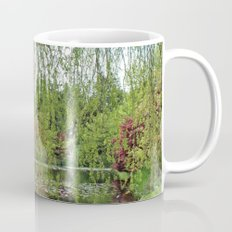 Lovely, soft green spring willow tree by the pond Mug