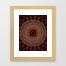 Brown mandala with red sun Framed Art Print