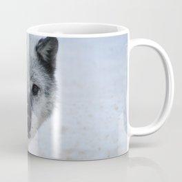 Lone wolf roams the Canadian Rockies Coffee Mug