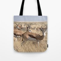 greg guillemin Tote Bags featuring Springbok herd - Greg Katz by Artlala for MSF Doctors Without Borders