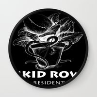 resident evil Wall Clocks featuring Skidrow resident by Darius Malone