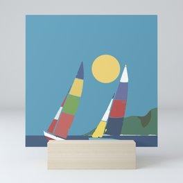 Sails below the coast Mini Art Print