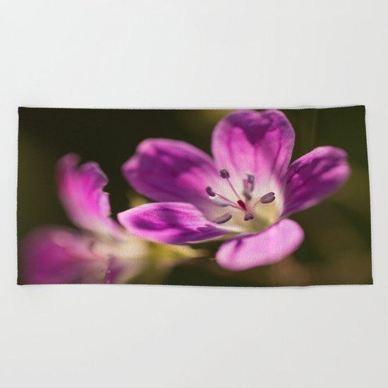 Purple glow in forest Beach Towel
