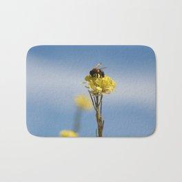 Honey bee on a wildflower Bath Mat