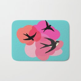 Spring swallows and clouds Bath Mat