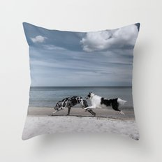 Running dogs at the beach Throw Pillow