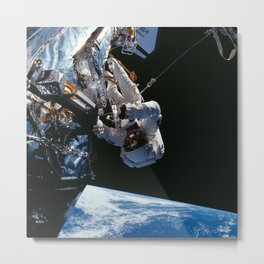 NASA Astronaut F. Story Musgrave during one of five spacewalks Repairing Hubble Space Telescope Metal Print