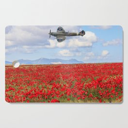 World War II Supermarine spitfire fighter plane flying over poppy field Cutting Board