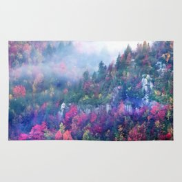 Fog over a colorful fall mountain forest Rug