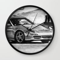 porsche Wall Clocks featuring Porsche  by Marcela Caraballo