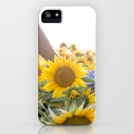 Couple holding hands in a sunflower field iPhone Case