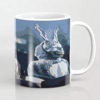 donnie darko Mugs featuring Donnie Darko by Kevin Patrick Reilly II