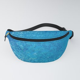 Raising underwater bubbles in the blue sea Fanny Pack