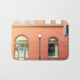 Street photography brick building afternoon I Bath Mat