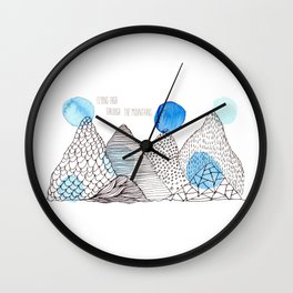 Flying high through the mountains Wall Clock