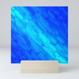 Glowing metallic blue fragments of yellow crystals on irregularly shaped triangles. Mini Art Print