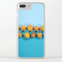 Ripe apricots on a blue background Clear iPhone Case