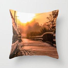 A beautiful sunrise view from a park footbridge Throw Pillow