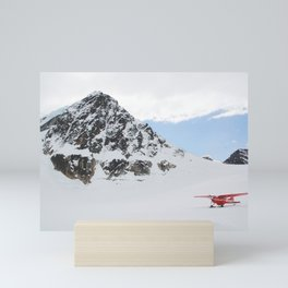 Small Plane Beside a Snow Covered Mountain Mini Art Print