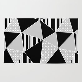 Black, gray polygonal geometric pattern. Rug