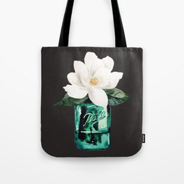 Magnolia in a glass jar with black background Tote Bag