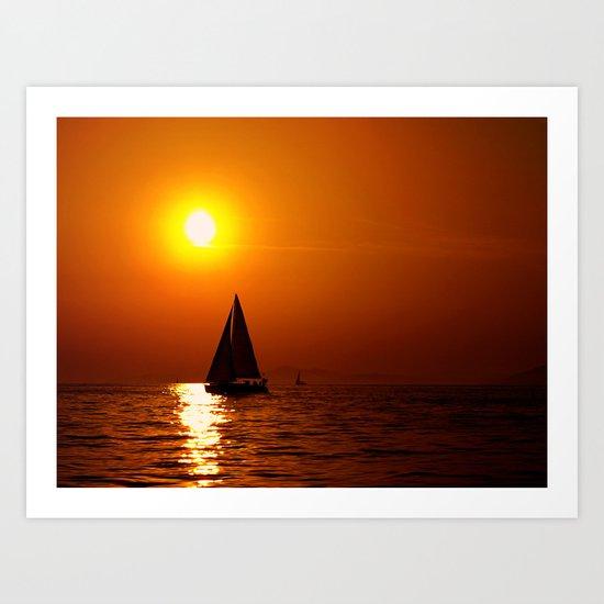 A sailboat at sunset Art Print