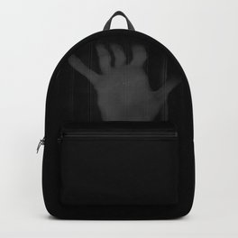 Distorted hand of a man in the dark. Backpack