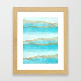 Gold and blue sea Framed Art Print