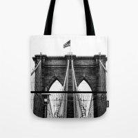 brooklyn bridge Tote Bags featuring Brooklyn Bridge by Graham Dunk