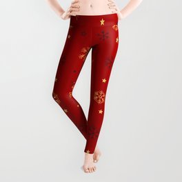 Red background with black and gold snowflake xmas pattern Leggings