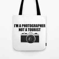 photographer Tote Bags featuring Photographer Tourist Funny by bitobots