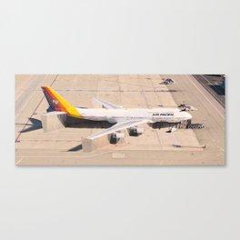 Stuck on the tarmac Canvas Print