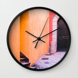 Colored yellow and red buildings Wall Clock