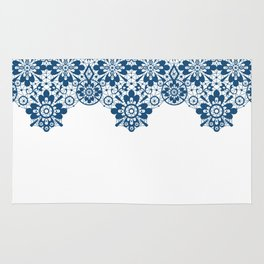 Blue lace on white background . Rug
