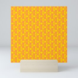 Chaotic pattern of dark yellow rhombuses and orange triangles in a zigzag. Mini Art Print