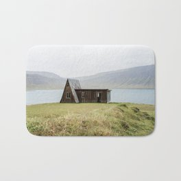 House in front of the lake Bath Mat