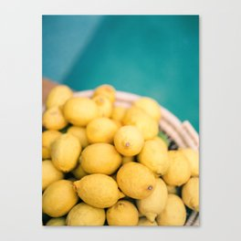 Yellow lemons next to a turquoise pool. | Colorful food photography, tropical feel. Canvas Print
