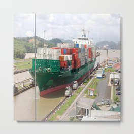 A cargo ship crossing the Miraflores locks at the Panama Canal Metal Print