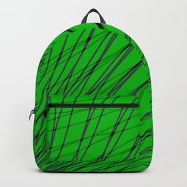 Rays of green light with mirrored dark waves on dark. Backpack