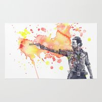 rick grimes Area & Throw Rugs featuring Portrait of Rick Grimes from The Walking Dead by idillard
