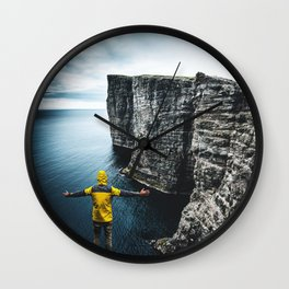 explorer on top of the rock Wall Clock
