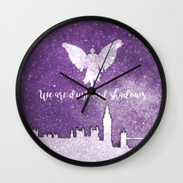 We are dust and shadows Wall Clock