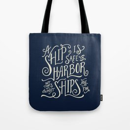 A ship is safe in harbor but that's not what ships are for. Hand lettered nautical quote. Tote Bag