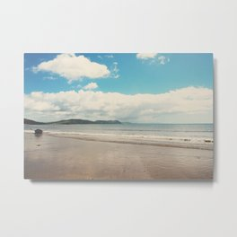A row boat abandoned on the beach at Lyme Regis, England Metal Print