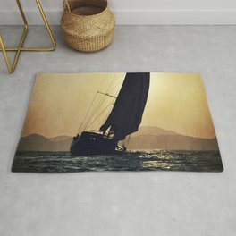 sailboat and sunset Rug
