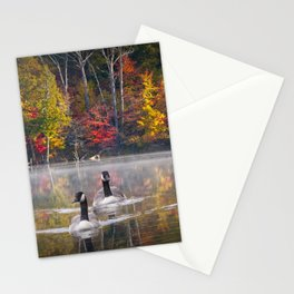 Two Canada Geese swimming in Fall Stationery Cards