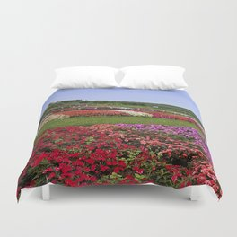 Floral patchwork under a blue sky Duvet Cover