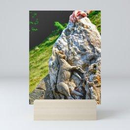 Sculpted goat in rock mountain Mini Art Print