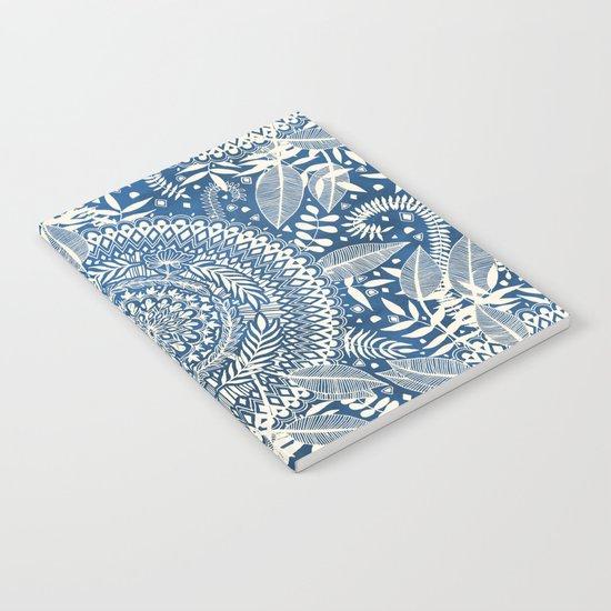 Diamond and Doodle Mandala On Blue Notebook